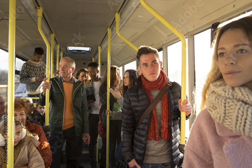 People travelling on a bus Poster