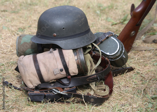 helmet with a rifle in the army camp during a war exercise
