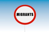 stop road sign with migrants text poster