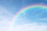 rainbow in the clear blue sky after the rain, the rainy season. - 88124567