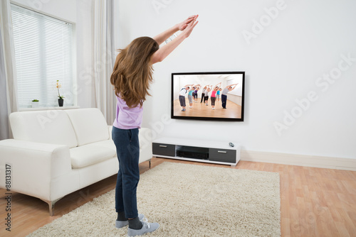 Girl Doing Exercise At Home