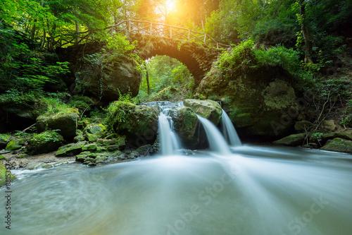 Panel Szklany Bridge over a fairy tale waterfall