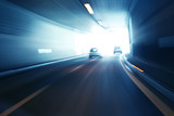 Fototapety Blurry silver blue color tunnel high speed car driving. Motion blur visualizies the speed and dynamics.
