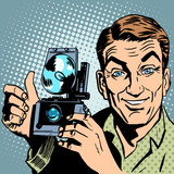 Fototapety Photographer with retro camera hand gesture all is well