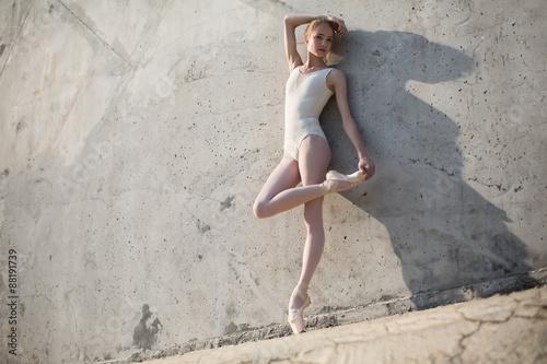 Slim dancer stands in a ballet pose Plakát