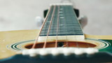 Detail of classic guitar with shallow depth of field for the Aesthetics. poster