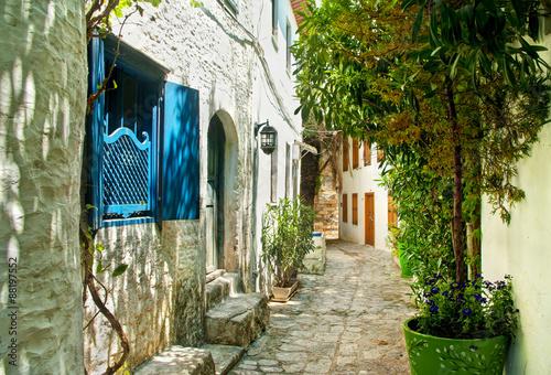 Obraz na Szkle narrow street in old european town on sunny day