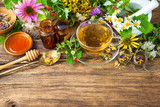 Fototapety Cup of herbal tea with wild flowers and various herbs