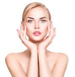 Fototapety Beautiful young woman Portrait. Beautiful spa girl touching her face