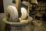 Ancient olive oil production machinery, stone mill and mechanical press - 88263907