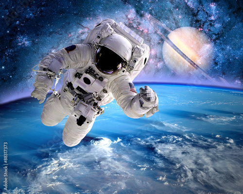 Plexiglas Nasa Astronaut spaceman outer space planet saturn earth universe. Elements of this image furnished by NASA.