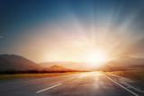 Sunrise above road - 88339183