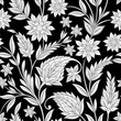 seamless paisley ornament with flowers on black background