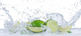 Fresh limes with water splashes