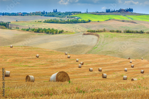 Fotobehang Old town and straw bales in Tuscany,Italy,Europe