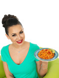 Beautiful Attractive Young Hispanic Woman Holding A Plate Of Mexican Chilli Rice