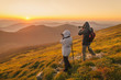 Постер, плакат: Photographers takes a sunset in the mountains