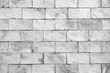 Grey brick wall texture and background.
