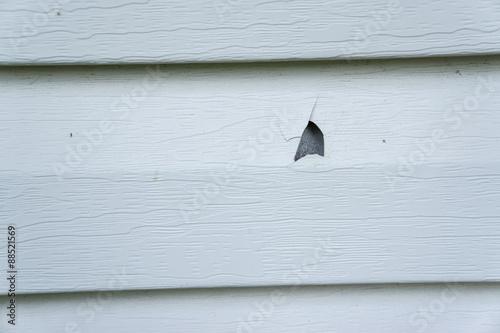 Hail damage on vinyl siding of a house stock photo and for Hail damage vinyl siding