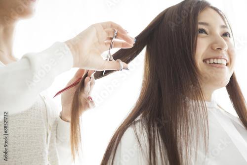 Hairdresser has cut the long hair of women