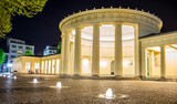 Fototapety People are sitting in front of illuminated elisenbrunnen in german Aachen.
