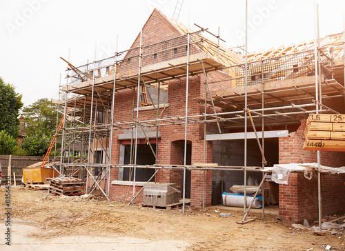 Fototapeta Building Site With House Under Construction