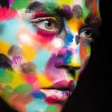 Fototapety Girl with colored face painted. Art beauty image.