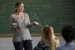 Female teacher teaching in class