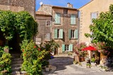 Beautiful stone houses on a street in a quaint village in Provence, France