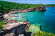 Bruce Peninsula at Cyprus lake, Ontario stunning, gorgeous amazing natural rocky beach view and tranquil azure clear water with people in background on sunny beautiful, day