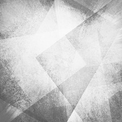 abstract gray background with white faded grunge rectangle shapes layered in random angled patterns