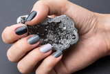Fototapety Female hand with textured silver mineral