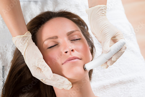 poster of Woman Receiving Microdermabrasion Therapy