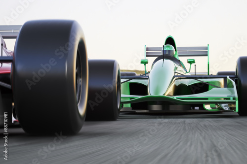Fotografiet Motor sports race car competitive close quarters racing on a track with motion b