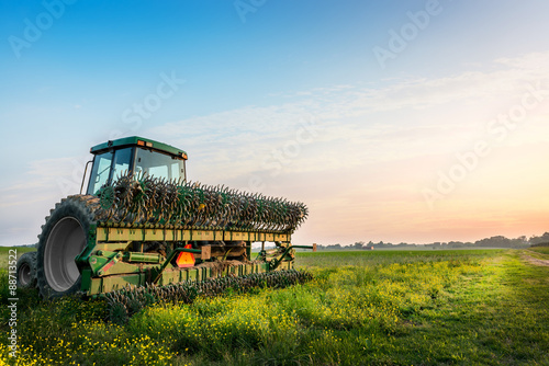 Tractor in a field on a rural Maryland farm Poster
