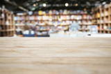 Fototapety Table top Counter with Blurred Bookshelf Bookstore Background