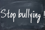 stop bullying text write on blackboard poster