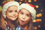 Fototapety Christmas Happy funny children twins sisters