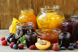 Assorted fruit berry jams (apricot, strawberry, raspberry, orange)