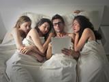 Fototapety Man sleeping with three women