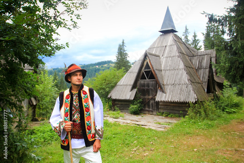 Poster young man wearing hutsul costume in western ukraine