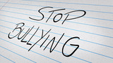 Stop Bullying written on a note pad poster