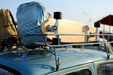 Board for skateboard and backpack on the roof of the car