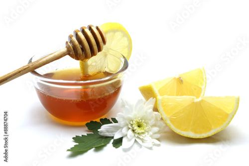 Poster Honey and lemon on white background