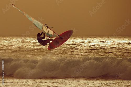 fototapeta na ścianę windsurfer jumping in a sunset sky