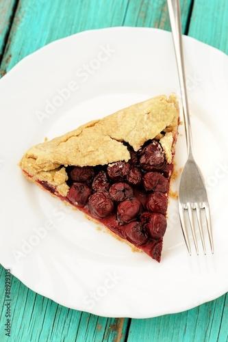 Homemade vegan wholegrain galette with wild cherries with fork i © alexeyborodin