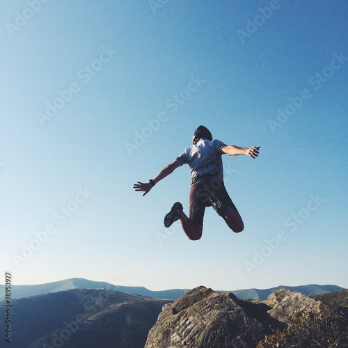 Foto op Aluminium Exclusieve extreme man jump with rock in mountains