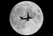 airplane and a full moon