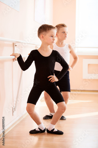 Young boys working at the barre in a ballet dance class. © Andrey Bandurenko