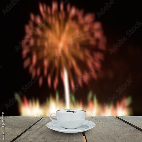Fireworks blur background and coffee on terrace wood Poster